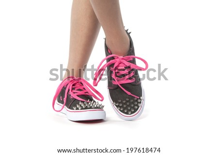 close-up View of young women  wearing new fashion shoes with studs  - stock photo