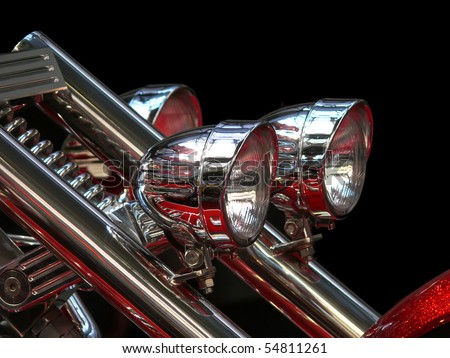Close-up view on chrome headlights of luxury bike - stock photo