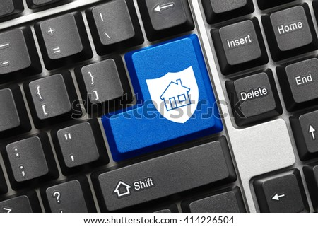 Close-up view on conceptual keyboard - Blue key with shield and home symbols - stock photo