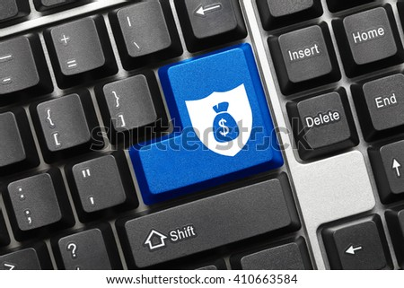 Close-up view on conceptual keyboard - Blue key with shield and moneybag symbols - stock photo