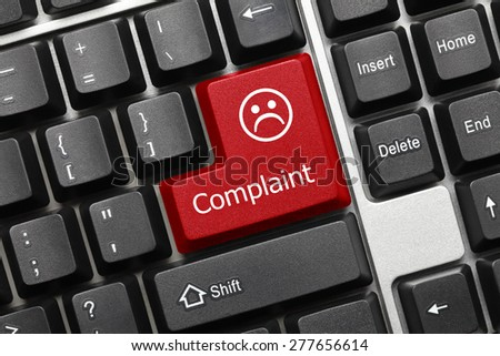 Close-up view on conceptual keyboard - Complaint (red key) - stock photo