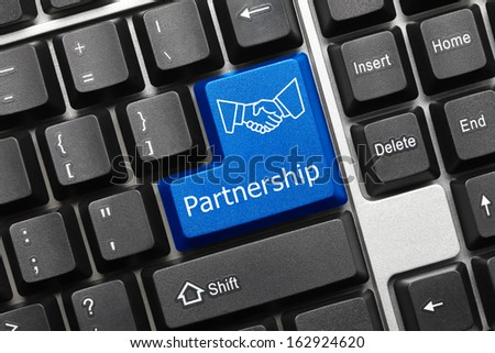 Close up view on conceptual keyboard - Partnership (blue key with handshake symbol)