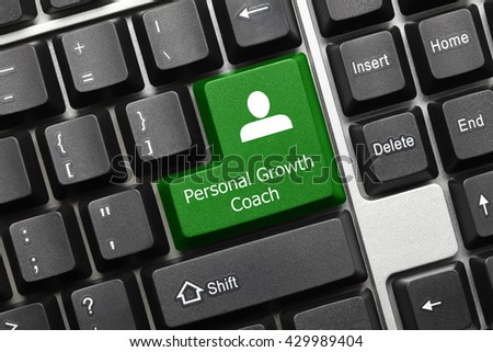 Close-up view on conceptual keyboard - Personal Growth Coach (green key) - stock photo