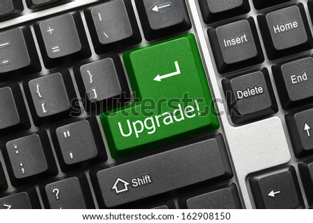Close up view on conceptual keyboard - Upgrade (green key) - stock photo
