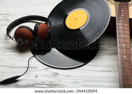Close up view on musical equipment against grey wooden background - stock photo