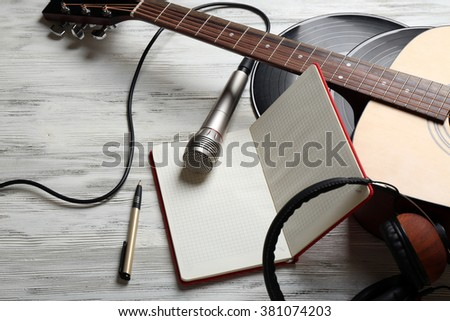 Close up view on musical equipment against grey wooden background
