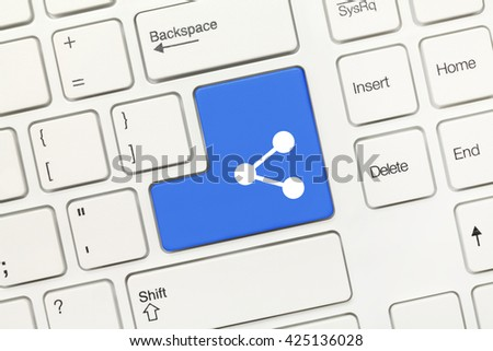 Close-up view on white conceptual keyboard - Blue key with share symbol - stock photo