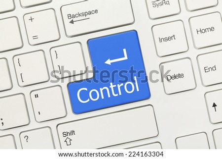 Close-up view on white conceptual keyboard - Control (blue key)