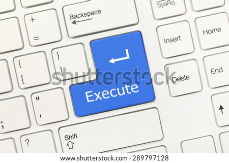Close-up view on white conceptual keyboard - Execute (blue key) - stock photo