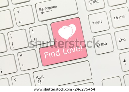 Close-up view on white conceptual keyboard - Find Love (pink key) - stock photo