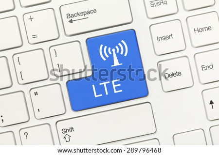 Close-up view on white conceptual keyboard - LTE (blue key) - stock photo