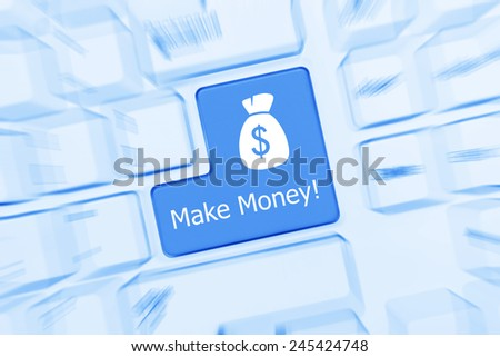 Close-up view on white conceptual keyboard - Make Money (blue toned). Zoom effect - stock photo