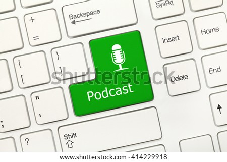 Close up view on white conceptual keyboard - Podcast (green key) - stock photo