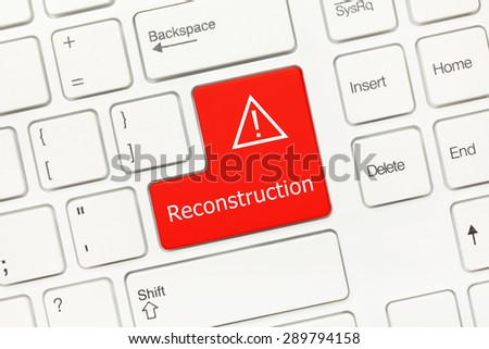 Close-up view on white conceptual keyboard - Reconstruction (red key) - stock photo