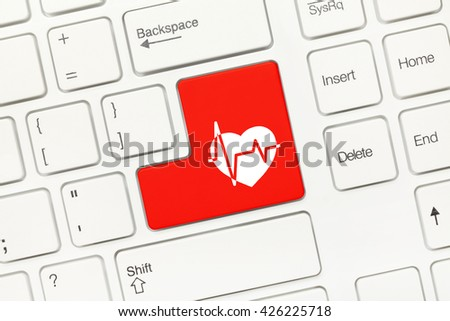 Close-up view on white conceptual keyboard - Red key with cardiology symbol - stock photo