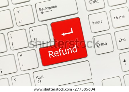Close-up view on white conceptual keyboard - Refund (red key) - stock photo