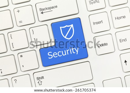 Close up view on white conceptual keyboard - Security (blue key with shield)
