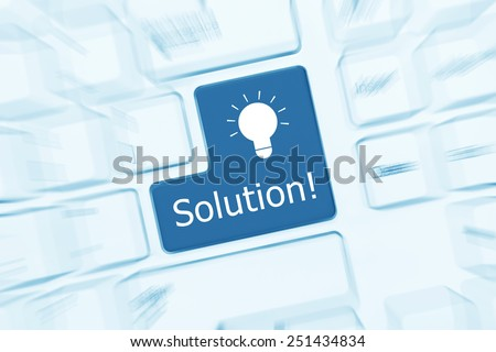 Close-up view on white conceptual keyboard - Solution key (blue toned). Zoom effect - stock photo