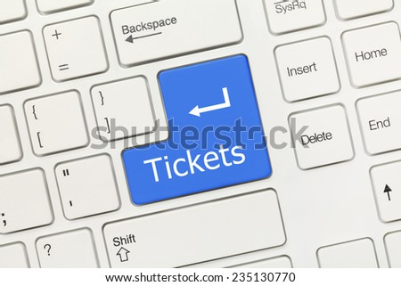 Close-up view on white conceptual keyboard - Tickets (blue key)