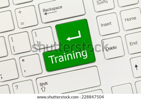 Close-up view on white conceptual keyboard - Training (green key) - stock photo