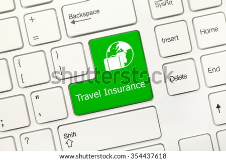Close-up view on white conceptual keyboard - Travel Insurance (green key) - stock photo