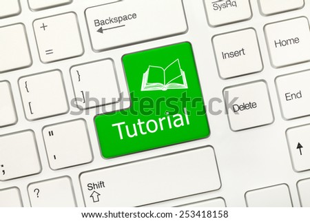 Close up view on white conceptual keyboard - Tutorial (green key) - stock photo