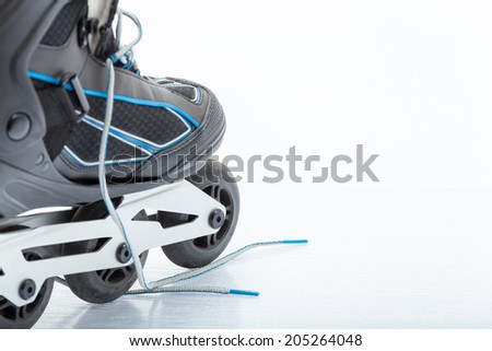 Close up view, on white, of inline skate or rollerblade - stock photo