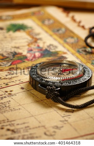 close up Vintage map with and compass in wwarm tone lighting - stock photo