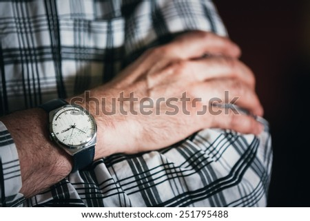 Close Up Vintage Old Watch On Man Hand. Men Wear In Striped Shirt - stock photo