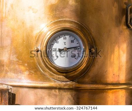 close-up vintage pressure gauge on vessel - stock photo