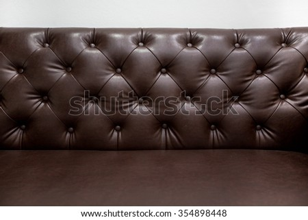 close up, vintage style, the leather sofa and concrete wall - stock photo