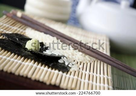 close up wasabi with seaweed on bamboo mat - stock photo