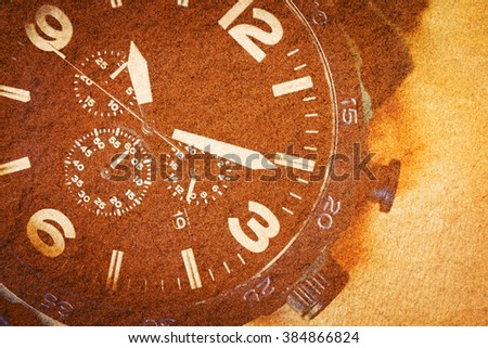 Close up watch on sand stone texture background