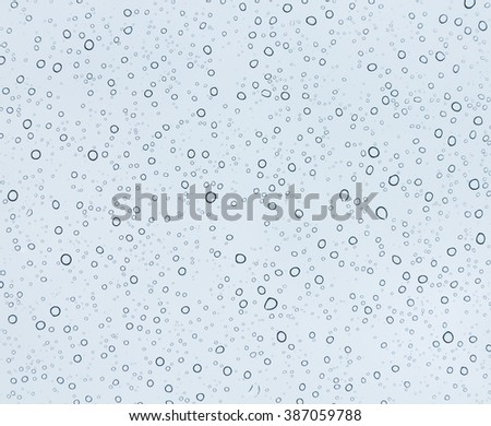 Close up water bubbles on glass blue background - stock photo