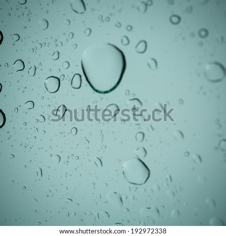 Close up water drop from rain on the window - stock photo