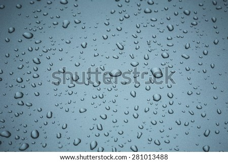 Close up water drop on body of car for background