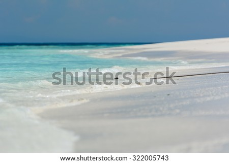 close up wave on beautiful beach,soft focus