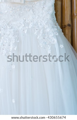Close up Wedding dress of the bride. Curve shape of dress for bridal in wedding party.