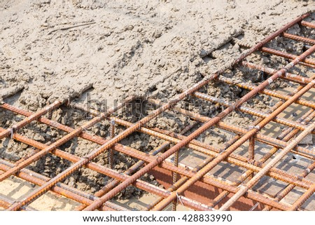 Close up wet cement pour on deformed steel bars with tiewires in construction site, floor pouring, rebar, building, reinforcement construction, steel, reinforced concrete - stock photo