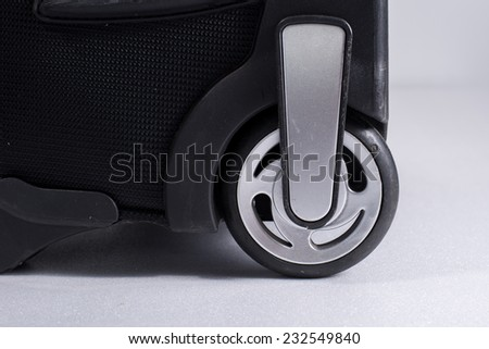 close up Wheel suitcase - stock photo