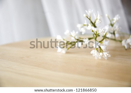 close up white artificial flowers put on table