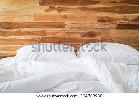 Close up white bedding sheets and pillow, Messy bed concept - stock photo