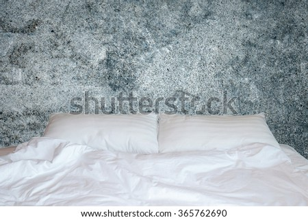 Close up white bedding sheets and pillow on wooden wall room background,  bed concept - stock photo