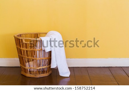 Close up white color used towels in wicker basket - stock photo