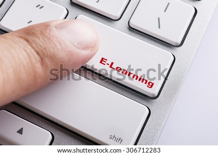 Close up white keyboard button conceptual-E-learning