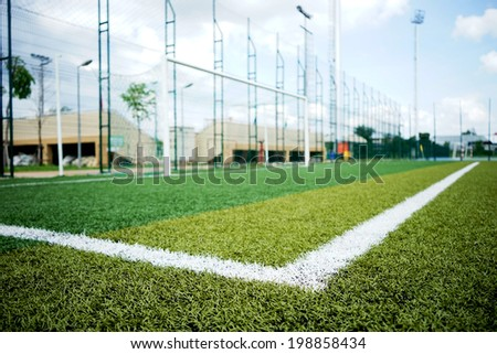 close up White line on a soccer field grass - stock photo