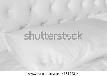 Close up white pillow on white luxury bed. - stock photo
