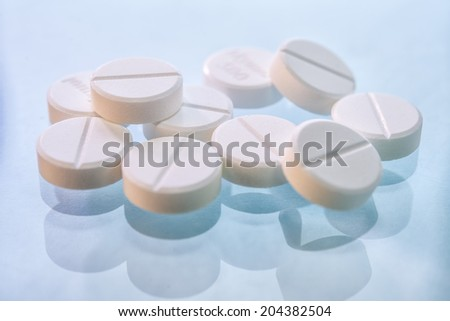 Close up white tablet pills  - stock photo