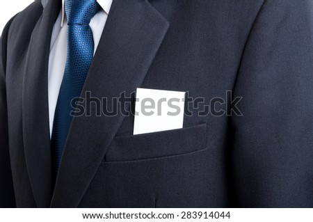 Close up with blank business card in business man suit jacket pocket - stock photo