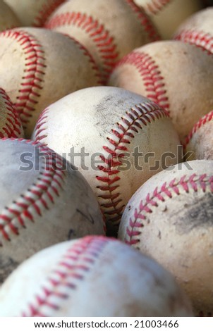 Close up with depth of field of old baseballs close together